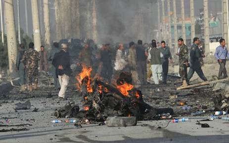 A  suicide bomber blew himself up alongside a minivan carrying foreigners on a major highway leading to the international airport in the Afghan capital, police said, killing at least 10 people, including nine foreigners. Picture: AFP.