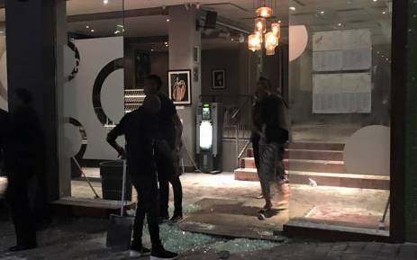 Staff members of the Orbit jazz club clean up after a group, believed to be protesters, vandalised the popular club on Friday 14 October 2016. Picture: Aymeric Peguillan/Facebook.