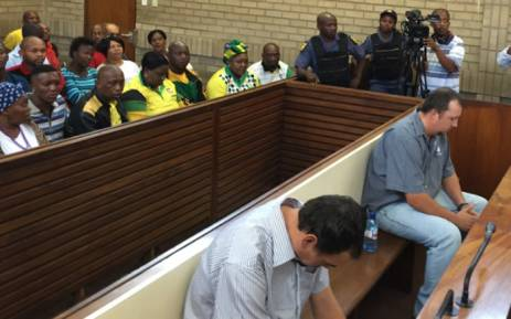 Two white South Africans convicted in coffin assault of black man