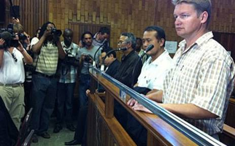 Chumlong Lemtongthai and his accomplices Punpitak Chunchom and Marnus Steyl appear in court on 08 November 2011 after they were arrested for allegedly running a rhino poaching syndicate. Picture: Alex Eliseev/EWN