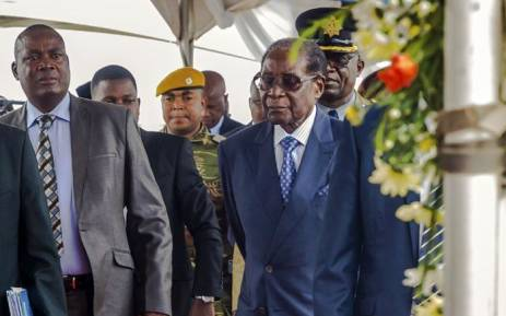 Former Zimbabwean President Robert Mugabe (right) arrives for a graduation ceremony at the Zimbabwe Open University in Harare on 17 November 2017. This is his first public appearance since a military takeover on 14 November 2017. Picture: AFP