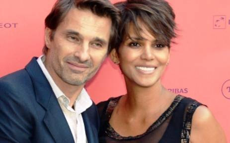 "FILE: US actress Halle Berry (R) poses with her fiance French actor Olivier Martinez, on 13 June,2013 during a photocall upon their arrival for the ""Toiles enchantees"" event, as part of the Champs-Elysees film Festival in Paris. Picture:AF"