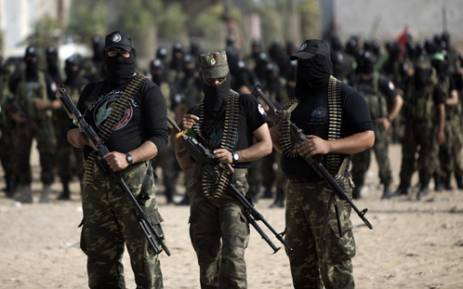 FILE: Palestinian militants of the Ezzedine al-Qassam Brigades, Hamas's armed wing, stage an anti-Israel parade as part of the celebrations marking the first anniversary of an Israeli army operation in the Gaza Strip on 14 November 2013. Picture: AFP.