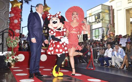 Minnie Mouse poses with Disney CEO Bob Iger and singer Katy Perry while being honoured with the 2,627th star on the Hollywood Walk of Fame on 22 January 2018 in Hollywood, California. Picture: AFP