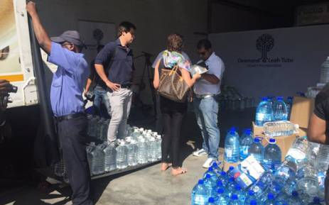 Thousands of liters of water is being unloaded at Focus Fabrics in Cape Town. Picture: Monique Mortlock/EWN