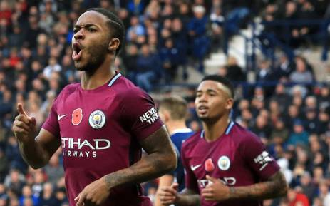 Manchester City's English midfielder Raheem Sterling (R) celebrates scoring the team's third goal with Manchester City's English defender Kyle Walker during the English Premier League football match between West Bromwich Albion and Manchester City at The Hawthorns stadium in West Bromwich, central England, on 28 October 2017. Picture: AFP.