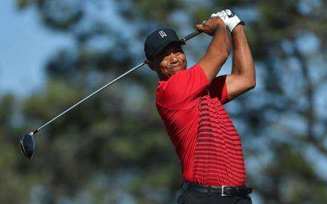 FILE: Tiger Woods plays his shot from the fifth tee during the final round of the Farmers Insurance Open at Torrey Pines South on 28 January, 2018 in San Diego, California. Picture: AFP.