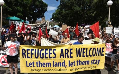 FILE: Protesters march on the streets of Sydney's central business district against US President Donald Trump's travel ban policy on 4 February, 2017. Picture: AFP