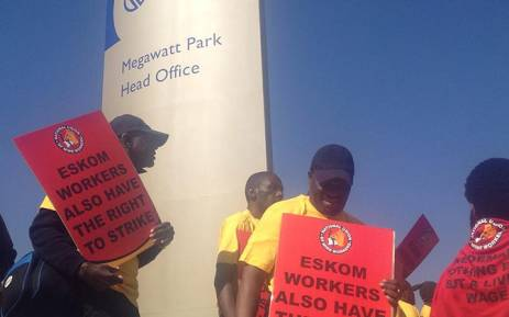 FILE: The National Union of Mineworkers (NUM) members protest outside Eskom offices in Morningside, northern Johannesburg on 4 August 2014 against essential services designation of Eskom staff. Picture: EWN.
