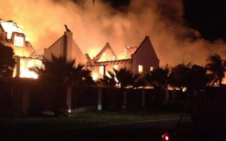 Houses ablaze in St Francis Bay on 11 November 2012. Picture: Supplied.