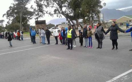 Locals form a human chain through Ocean View to highlight the issues of crime in the area. Picture: Gavin Davis/EWN.