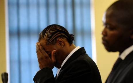 "Musician Molemo ""Jub Jub"" Maarohanye is seen during the handing down of judgment in his and co-accused (front) Themba Tshabalala's murder trial at the Protea Magistrate's Court in Soweto, Wednesday, 10 October 2012. The two were allegedly drag-racing in Protea North in March 2010 when they crashed into a group of schoolchildren. Four boys were killed and two were seriously injured. Picture: Werner Beukes/SAPA"