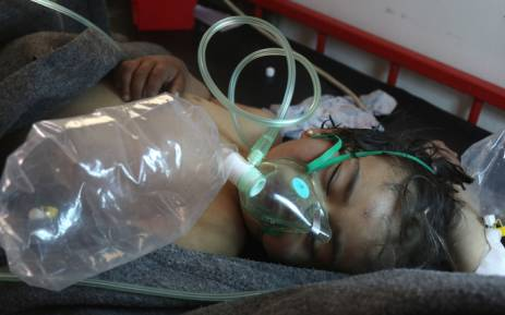 A Syrian child receives treatment following a suspected toxic gas attack in Khan Sheikhoun, a rebel-held town in the northwestern Syrian Idlib province on 4 April 2017. Picture: AFP