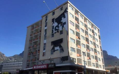 The billboard was also been deemed illegal by the City of Cape Town. Picture: Xolani Koyana/EWN.