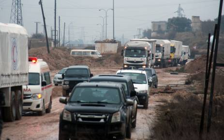 A convoy of aid vehicles drive in Syria's Idlib province as they head to the government-controlled towns of Fuaa and Kafraya to deliver aid on 11 January, 2016. Picture: AFP.