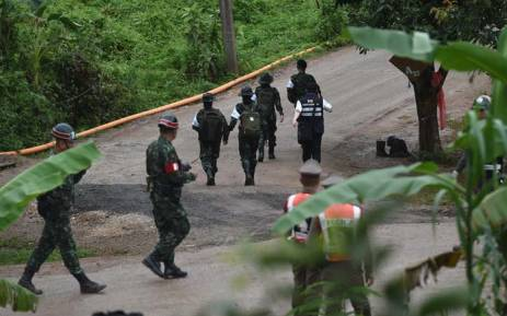 Thai military paramedics head to Tham Luang cave area as divers began evacuation of the 12 boys and their coach trapped at the cave in Khun Nam Nang Non Forest Park. Picture: AFP.
