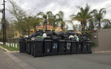 Pikitup workers have been striking in Johannesburg CBD this week emptying trash in the streets and not collecting refuse in Johannesburg. Picture: Tara Meaney/EWN.