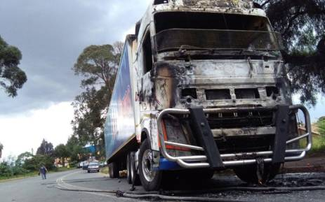 The fruit and vegetable truck was first looted and then set on fire on main reef road in Roodepoort. Picture: Victor Magwedze/EWN