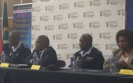 Police Minister Fikile Mbalula and SAPS officials waiting to address community members in Nyanga, Cape Town. Picture: Graig-Lee Smith/EWN.