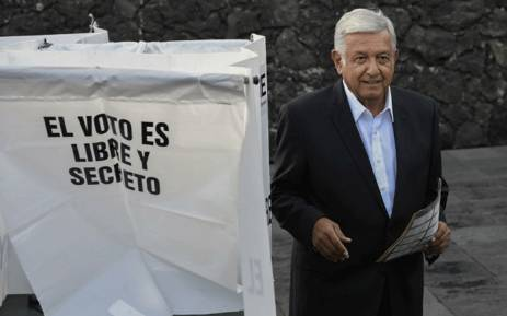 """Mexico's new president Andres Manuel Lopez Obrador for the """"Juntos haremos historia"""" party, casts his vote during general elections, in Mexico City, on 1 July, 2018. Picture: AFP."""