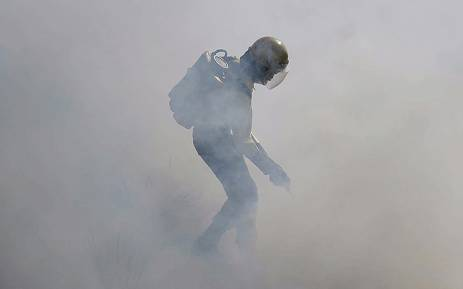 A firefighter attends to a fire. Picture: @wo_fire/Twitter
