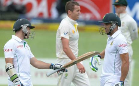 Proteas' batsmen Dean Elgar and Faf du Plessis share a moment during the first day of the second Test against Australia in Port Elizabeth on 20 February 2014. Picture: Facebook.
