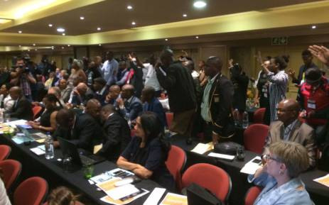 Students raise their hands and want to make submissions during the fees commission. Picture: Barry Bateman/EWN.