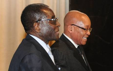 Mugabe arrives in South Africa for meeting