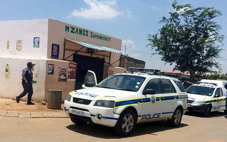 Police deployed to Doornkop on 20 January 2015 where foreign-owned shops were looted by angry residents. Picture: Thando Kubheka/EWN.