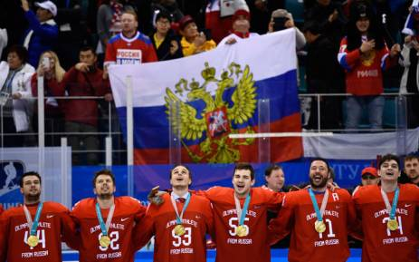 The Olympic Athletes from Russia's players sing the Russia national anthem after receiving their gold medals after the men's gold medal ice hockey match between the Olympic Athletes from Russia and Germany during the Pyeongchang 2018 Winter Olympic Games. Picture AFP