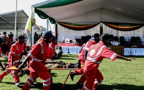 Injured people are evacuated after an explosion at the stadium in Bulawayo where Zimbabwe President just addressed a rally on 23 June 2018.  Picture: AFP
