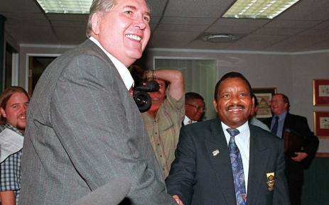 Dr Louis Luyt (L), President of South African Rugby Football Union (SARFU), shakes hands with Dr G. Sam, who led the delegation of National Sports Council (NSC), at NSC headquarters in Johannesburg 07 April. In a surprise move, SARFU boss Louis Luyt, who has been at the centre of the dispute, arrived at the talks after saying earlier he would not take part in the discussions. Picture: AFP.