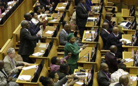 African National Congress (ANC) MPs celebrate an unsuccessful vote of no-confidence against President Jacob Zuma on August 8, 2017 in the National Assembly in Cape Town. Picture: AFP