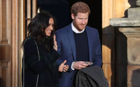 Britain's Prince Harry (R) and his fiancée US actress Meghan Markle leave a reception for young people in the Palace of Holyroodhouse in Edinburgh, during their visit to Scotland on 13 February 2018. Picture: AFP