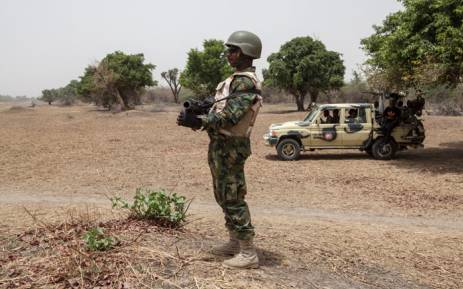 A Nigerian soldier stands guard near the Yobe river on the outskirt of the town of Damasak in North East Nigeria in April 2017 as thousands of Nigerians, who were freed in 2016 by the Nigerian army from Boko Haram insurgents, return to their homes in Damasak. Picture: AFP.