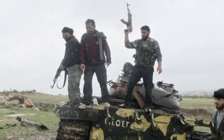 A group of rebels on a tank in Darkoush, Syria. Picture: Rahima Essop/EWN.