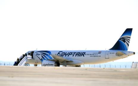 Passengers leave an EgyptAir Airbus A-320 sitting on the tarmac of Larnaca airport after it was hijacked and diverted to Cyprus on March 29, 2016. Picture: AFP