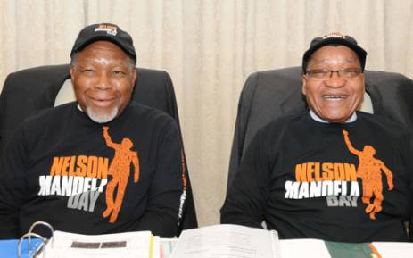 Deputy President Kgalema Motlanthe and President Jacob Zuma wearing their Nelson Mandela Day shirts & caps. Picture: GCIS