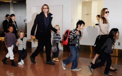 FILE: Accompanied by their children, Brad Pitt and Angelina Jolie at Haneda Airport in Tokyo on 8 November 2011. Picture: AFP.