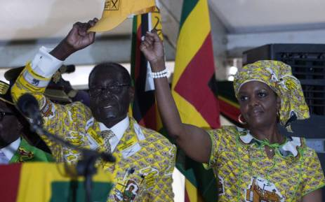 Zimbabwean President and Zanu PF leader Robert Mugabe (L) and his wife Grace greets delegates during the official opening of the 6th People's Congress of Zanu-PF in Harare on 4 December, 2014. Picture: AFP.