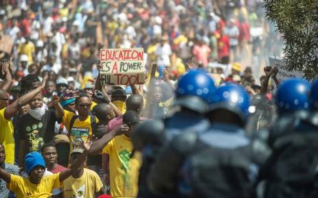 FILE: Police face off against protesting students on the south lawn of the Union Buildings in Pretoria during the Fees Must Fall march on 23 October 2015. Picture: AFP