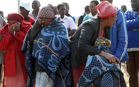 Family members grieve at a memorial service for the victims of the Lonmin shooting. Picture: Taurai Maduna/EWN.