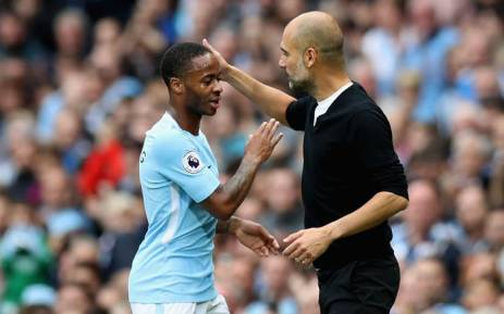 Manchester City's manager Pep Guardiola congratulates Raheem Sterling on his 51st career goal. Picture: @ManCity/Twitter.