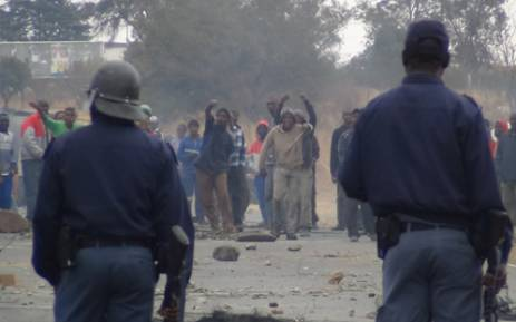 Police clashed with residents from Kagiso in the West Rand during a service delivery protest on 31 July, 2012. Picture: Christa Van der Walt/EWN