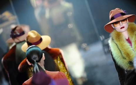 FILE: Models display creations as part of Gucci Fall-Winter 2011-2012 ready-to-wear collection on 23 February 2011 during the Women's fashion week in Milan. Picture: AFP.