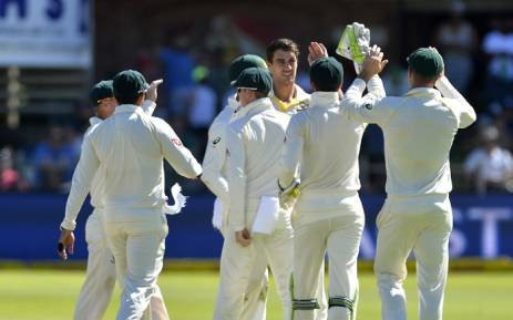Australia's Pat Cummins celebrates with teammates after taking his fourth wicket against South Africa on the opening day of the third Test. Picture: @OfficialCSA/Twitter.
