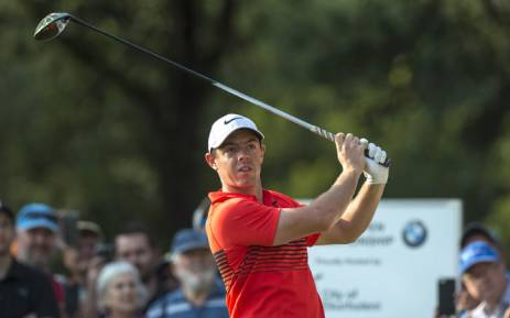 FILE: Rory McIlroy keeps an eye on his shot. Picture: AFP