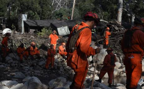 A Cal Fire inmate crew rests while looking for survivors of a massive mudflow in Montecito, California, on 10 January 2018. Picture: AFP