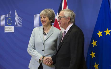 Britain's Prime Minister Theresa May and European Commission President Jean-Claude Juncker shake hands during a news conference at the EC headquarters in Brussels. Picture: @theresa_may/Twitter.