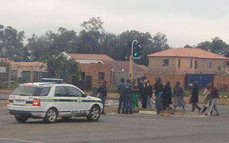 Police attend to protests in Lenasia's Ext 13. Picture: @shamiknanoo via Twitter.